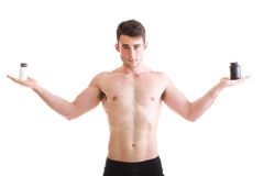 Holding a boxes with supplements on his biceps Royalty Free Stock Photography