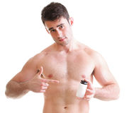 Holding a boxes with supplements on his biceps Royalty Free Stock Images
