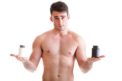 Holding a boxes with supplements on his biceps Stock Photo