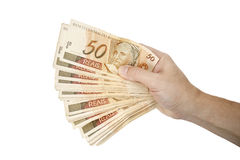 Holding Brazilian money Stock Photo