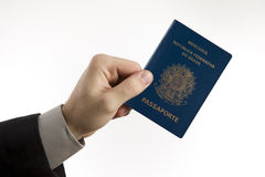 Holding a Brazilian passport. Royalty Free Stock Image