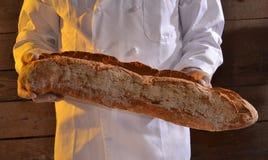 Holding Bread Royalty Free Stock Photo