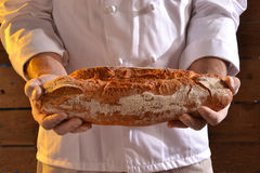 Holding a Bread Royalty Free Stock Images