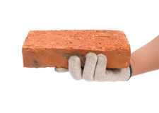 Holding a brick stock image