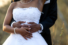Holding the bride. An African-American bridal couple holding each other Stock Photos