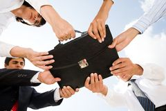 Holding briefcase Royalty Free Stock Photo