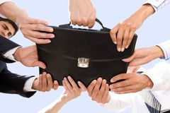 Holding briefcase Stock Photo