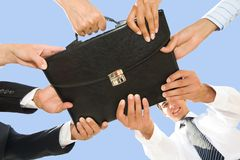 Holding briefcase Stock Images