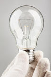 Holding bulb Royalty Free Stock Photo