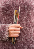 Holding bunch of paint brushes Royalty Free Stock Images