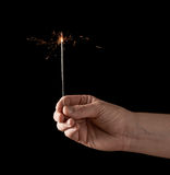 Holding a burning sparkler Stock Image