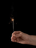 Holding a burning sparkler Royalty Free Stock Images