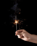 Holding a burning sparkler Royalty Free Stock Photography