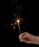 Holding a burning sparkler Royalty Free Stock Photo