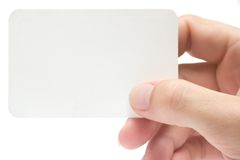 Holding a Business Card. Female hand holding a blank business card. Add your own text stock photos