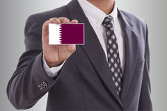 Holding a business card Stock Photography