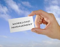 Business card with workload management. Holding Business card with workload management Stock Photo