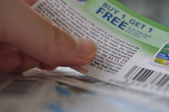 Holding buy one get one free coupon Stock Photo