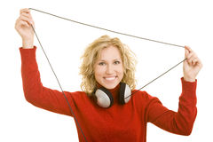Holding a cable. Blonde woman holding the cable of her headphones royalty free stock image