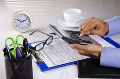 Holding calculator Stock Image