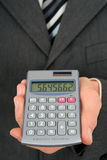 Holding a Calculator Stock Image