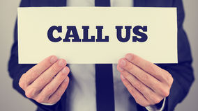Holding Call us sign stock image