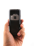 Holding a camera phone. Holding a sleek camera phone shot over white background Stock Image