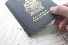 Holding Canada passport with boarding pass. Close up holding Canada passport with boarding pass Royalty Free Stock Photos
