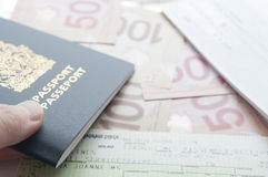 Holding Canada passport with boarding pass Stock Images