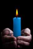 Holding a candle stock photography