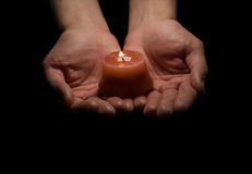 Holding a candle Royalty Free Stock Images