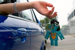 Holding car key Stock Photo