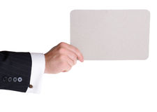 Holding carboard card. Hand holding cardboard card with copy space Royalty Free Stock Image