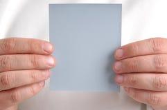 Holding card Stock Photo