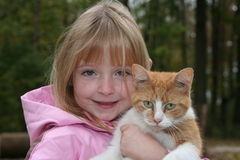 Holding a cat. Young girl holding a farm cat Stock Photo