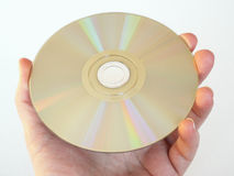 Holding a CD, CD-ROM or DVD. Hand holding a DVD Stock Images