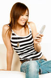 Holding cell phone Stock Images