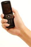 Holding the celular phone Stock Photos