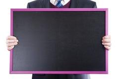 Holding chalkboard Stock Images