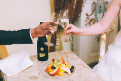 Holding champagne glasses Royalty Free Stock Photo