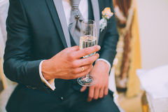 Holding champagne glasses Stock Images