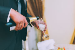 Holding champagne glasses Stock Image