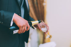 Holding champagne glasses Stock Photo