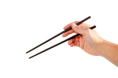 Holding chopsticks Royalty Free Stock Images