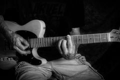 Holding chords on electric guitar black & white Stock Images