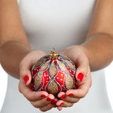 Holding christmas ball Royalty Free Stock Images