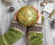 Holding Christmas Ornament Ball with Glitter and Sparkle. Female Hands Holding Christmas Ball Ornament with Glitter and Sparkle stock images