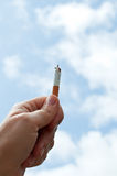 Holding a cigarette Royalty Free Stock Images