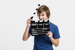 Holding a clapboard Stock Photo