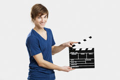 Holding a clapboard Stock Photos